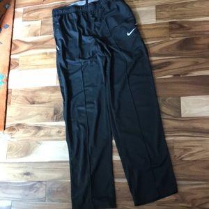 Nike workout pants, zipper side pockets.
